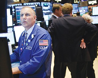 Traders work on the floor at the New York Stock Exchange in New York on Wednesday. Stocks surged on Wall Street after Senate leaders reached a deal that would avoid a U.S. default and reopen the government after 16 days of being partially shut down.