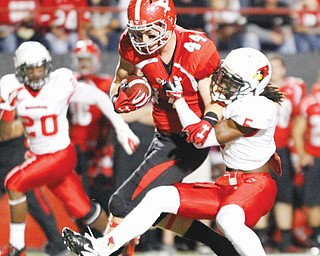 YSU tight end Nate Adams is corralled by Illinois State's Tevin Allen after catching a 27-yard pass for a first down in Saturday's 59-21 win at Stambaugh Stadium. This weekend, Western Illinois will try to disarm the Penguins' arsenal of weapons.