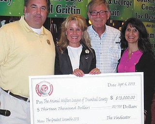 SPECIAL TO THE VINDICATOR The Greatest Golfer of the Valley summer tournament Greatest Scramble proceeds of $13,000 were donated Sept. 6 to the Animal Welfare League of Trumbull County. Todd Franko, left, editor of The Vindicator, presented the check to, from left, Caryn Covelli, Dr. Rufus Sparks and Cindy D'Amico, board members of the Animal Welfare League, at the 15th annual golf outing at Squaw Creek Country Club. The money will be used to renovate the former Thunderplex indoor baseball complex in Vienna into a 47,000 square-foot animal shelter.