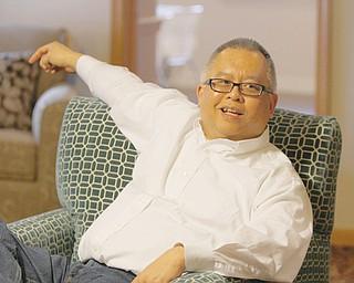 David Ho, owner of the American Scholar Group, an organization that brings in international students to study in the United States, relaxes in the hall's living area.