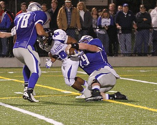 .          ROBERT  K. YOSAY | THE VINDICATOR.. Hubbbards #79  Matt Jones strips the ball from Polands #28  Marlon Ramirez .. Poland did recover but put them on the two yard line in the third quarter..Poland Bulldogs @ Hubbard Eagles