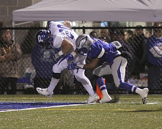 .          ROBERT  K. YOSAY | THE VINDICATOR.. Hubbards #2 Aries Shaw does his best to push Polands #20 Ross Gould out of bounds as Gould picks his way into the end zone..Poland Bulldogs @ Hubbard Eagles