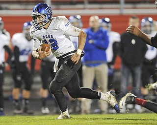 Lakeview quarterback #12 Angelo Marino scrambles with the football during the 2nd quarter of Friday nights game.