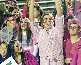 Kelli Cardinal/The Vindicator .Gabriel Bleacher, center, a senior at Ursulin, cheers with fellow senior Gabrielle Villaplana, left, during the second quarter Friday night at Stambaugh Stadium in Youngstown.