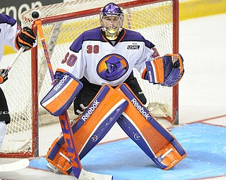 Phantoms goalie #30 Sean Romeo stands in goal ready to play the puck during 3rd period action of a game on Friday October 18, 2013.
