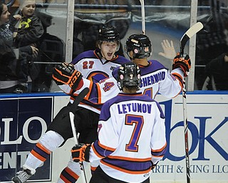 Phantoms #27 Luke Stork celebrates after scoring a goal with teammates #44 Kiefer Sherwood and #7Maxim Letunov during 3rd period action of a game on Friday October 18, 2013.