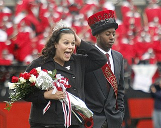 MADELYN P. HASTINGS | THE VINDICATOR..(L-R) 2013 YSU homecoming king and queen Melissa Wasser and Tyler Brentley walk across the field after being announced the winners during half time of the YSU vs Western Illinois game on October 19, 2013.... - -30-..