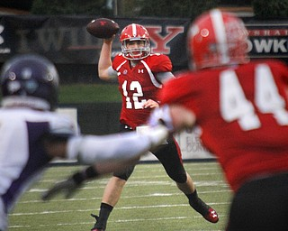 MADELYN P. HASTINGS | THE VINDICATOR..YSU's Kurt Hess (12) passes the ball during Youngstown's homecoming game against Western Illinois on October 19, 2013.... - -30-..