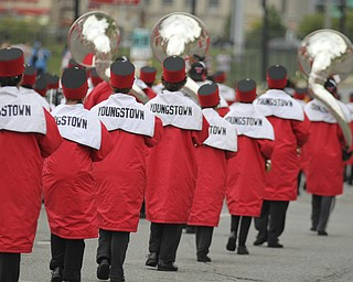The Youngstown State Marching Pride plays the fight song while walking up Fifth Ave. during the Homecoming parade in Youngstown on Saturday. Dustin Livesay  |  The Vindicator 10/19/13  Youngstown.