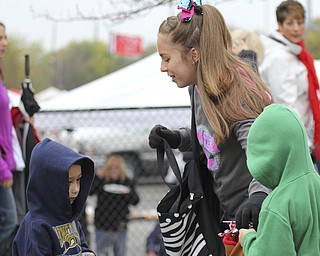 Deandra Maggs (13) of the Dream Team Allstars dance team hands out candy to Mike Frohman (5) and Landon Frohman (7) of Youngstown during the Homecoming parade on Fifth Ave. in Youngstown on Saturday. Dustin Livesay  |  The Vindicator 10/19/13  Youngstown.