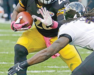 Ravens cornerback Lardarius Webb tries to stop Steelers running back Le'Veon Bell during Sunday's game at Heinz Field in Pittsburgh. Bell ran for a season-high 93 yards on 19 carries in Pittsburgh's 19-16 win over Baltimore.