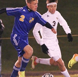 William D Lewis The Vindicator South Ranges (3) and Lake Center's (2) battle for the ball during  Tuesday action at SR.