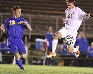 William D Lewis The Vindicator South Ranges (21) and Lake Center's (18) battle for the ball during  Tuesday action at SR.