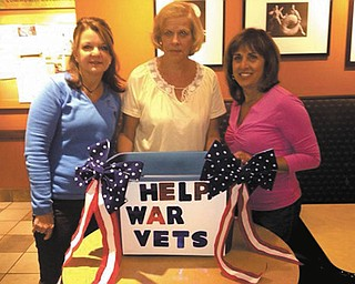 Cheryl Smaldino and Pam Ferguson, provisionals from Boardman-Poland Junior Women's League, are collecting nonperishable food items, grocery gift cards and 3-by 5-foot lap afghans for the veterans at the Veterans Administration Clinic Food Bank on Belmont Avenue. Pictured, from left, are Smaldino, Ferguson and Sperry Rongone, a league member. Drop-off locations are Save-A-Lot, 223 Boardman-Canfield Road, Boardman Plaza; or Brian Smaldino D.D.S., 263 W. McKinley Drive, Suite 202, Poland. Gift cards should be mailed to Raymond James Financial Services, Attn. Linda Crish, 755 Boardman-Canfield Road, Suite F4A, Boardman, OH 44512. 