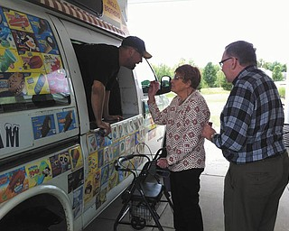 Southern Care Hospice recently sponsored the Jingle Brothers Ice Cream Truck for an afternoon of memories and ice cream treats for those living and working at Whispering Pines Assisted Living in Columbiana. Above are Donna Round and Lee Mackall choosing their treats from the Jingle Brothers ice cream man.