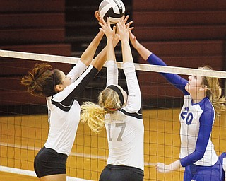 Hubbard's Kaylyn Garrett (20) attempts a spike as Crestwood's Taylor Atkins (8) and Morgan Strenk (17) block it during a Division II district semifinal at Boardman High School. Crestwood won in three games, 25-23, 25-14 and 25-19.