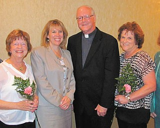 SPECIAL TO THE VINDICATOR The fall meeting of Catholic Collegiate Association recently took place at the Holiday Inn in Boardman. Ellen Sandel and Jeanne Pepperney were welcomed as new members. Speakers were The Rev. Richard Murphy, president of Ursuline High School, and Dr. Lois Cavucci, president of Lumen Christi. Above, from left, are Cathy Campana, president of CCA; Pepperney; Dr. Cavucci; the Rev. Mr. Murphy; Sandel; and Barbara Banks, vice president of CCA.