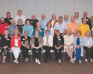 SPECIAL TO THE VINDICATOR Howland High School Class of 1963 met Sept. 6 for an informal evening at the home of classmate Ken James, and Sept. 7 for dinner at Leo's Ristorante in Howland to celebrate its 50th class reunion. Those attending, seated from left, are Carol (Falkinburg) Murdock, Janet (Goist) Buterbaugh, Janet (Capel) Biggin, Bonnie (Hayes) Lucich, Barb (Herig) Butler, Jane (Williams) Grinnell, Kathleen (Lab) Thoel, Leslie (Kline) Ryder, Beverly (Bellus) Lapp, Carolyn (Altsman) Szabo, Karen (Tomlin) Torrence, Karen (Gettig) Chin and Carole (Colgan) Enyings; in row two are Cheri (Runser) Boone, Jack Berry, Bill Goldman, Kathy (Miller) Klug, Barbara (Christopher) Blackshere, Leila (Kersey) Moore, Eileen (King) Schonrock, Jim Lazor, Ken James, Mike Datish and Barry Boone; and in back are Keith Price, Harry Ramsey, Jim Quinlan, Jack Ranck, Phil Hathaway, Tom Brain, Cecil Roberts, Allen Mason, Denny Phillips and Steve Chos.