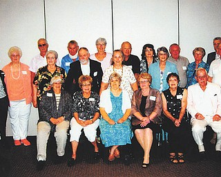 SPECIAL TO THE VINDICATOR Twenty-one members of the Springfield Local High School Class of 1958 recently met for its 55th reunion at Cafe 422 in Boardman. In the front row, from left, are Peggy (Belcher) Rummel, Janice (Gerner) Candle, Pudsie  (Watkins) Wolf, Becky (Bloomingdale) Mason, Carol (Janosko) Simcox and Chuck Wolf; in the middle are Jane (Moore) Moore, Bob Hughes, Dorothy (Cetor) Solomon, Alfreda (Black) Kaiser, Nina (Wichert) Parker and Paul Kovach; in back are Gail (Dinger) Taylor, Judy (Matta) Ferrett, Dave Shillinger, Ed Scholl, Lois (Hoehnle) Reader, Butch Metzka, Eloise (Coy) Simmons, Sam Allen and Cliff Grossen.