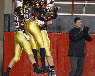 ROBERT K. YOSAY  | THE VINDICATOR..Mooneys #22 Mark Handel #8  Ahmad Moore and #69 Tyrell Rodgers celebrate a TD .. - -30-..