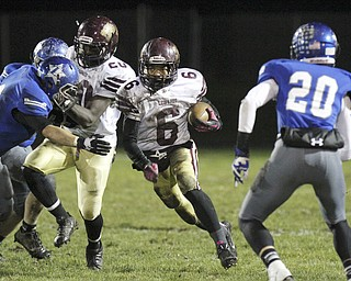 William D Lewisthe Vindicator Libety's (6) breaks through during 1rst half action at Lakeview.