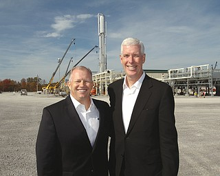 Jimmy D. Staton, left, executive vice president and CEO of Columbia Pipeline Group, and Robert C. Skaggs Jr., president and CEO of NiSource Inc., attend a dedication ceremony for the Hickory Bend plant in New Middletown.