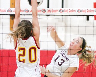 South Range's Stevie Taylor (13) tries to put down a spike as Cardinal Mooney's Gina Patella (20) goes for a block during last week's Division III district final. South Range will meet Wooster Triway tonight in a regional semifinal at Barberton High School.