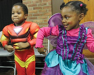 Jeremiah Robinson, 4, and Eleya Johnson, 3, dance during Black Knights Halloween event Wed at Wick Park.