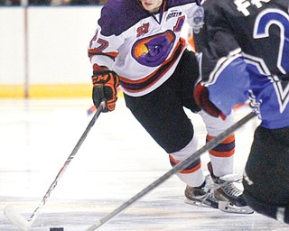 Phantoms' Luke Stork (27) reaches for the puck against the Lincoln Stars' Zach Frye (21) during their game