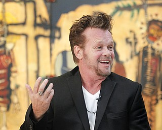 MADELYN P. HASTINGS | THE VINDICATOR..John Mellencamp discusses his painting during a reception to mark the opening of his exhibition of paintings at the Butler Museum of Art in Howland on November 2, 2013. ... - -30-..