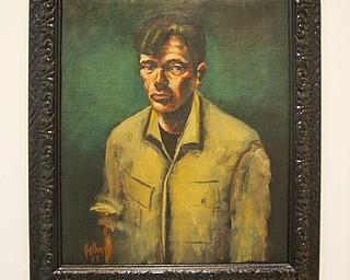 "MADELYN P. HASTINGS | THE VINDICATOR..A John Mellencamp painting titled ""Self with Green Background"", 1993, oil on canvas, courtesy of the artist. ... - -30-.."
