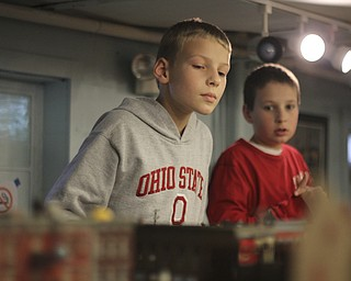 Siblings Clayton (9) and Blake (11) Marcum of Austintown watch the model trains during the 2013 Youngstown Model Railroad Assosiation openhouse in Austintown on Saturday.  Dustin Livesay  |  The Vindicator  11/2/13  Austintown.