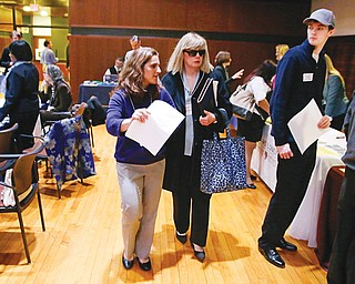 Maura Mazzocca attends a job fair for the visually impaired with the aid of volunteer guide Kate Loosian, left, at Radcliffe Yard in Cambridge, Mass., recently. The blind must overcome many hurdles in pursuit of full-time work.