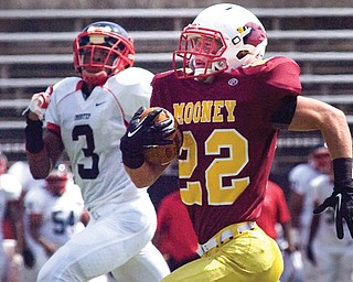 Cardinal Mooney running back Mark Handel races with Imhotep Charter defender Nyeem Thrones during a game Aug. 31 at Stambaugh Stadium. The Cardinals lost the game 49-21, but have earned a spot in the postseason thanks to a 6-4 record.