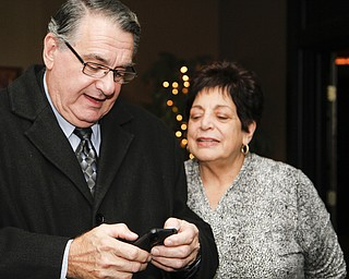 MADELYN P. HASTINGS I THE VINDICATOR..Ken and his wife Linda Carano looks at election results during their election party at Rachel's in Austintown on November 5, 2013.