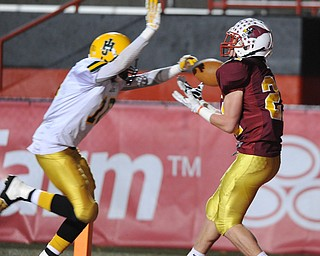Mooney #21 Tim Durkin catches a pass in the end zone for a touchdown after getting behind John Hay #10 Treyvon Akins during the 3rd quarter of Friday nights game.