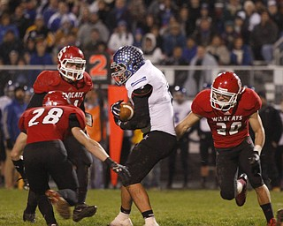 ROBERT K. YOSAY  | THE VINDICATOR...No Where To GO as  Lakeviews #6  Chris Romano is surrounded by #28  Anthony Farkas - Nick Pollifrone and #20 Marcus Donnadio .. during first half action.. - -30-.......