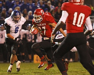 ROBERT K. YOSAY  | THE VINDICATOR...Struthers #27   Luke Witkowski breaks through the line and a first down as Lakeviews #6 Chris Romano and Struthers #10 Temeko Holness look on.. - -30-.......