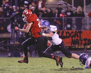 ROBERT K. YOSAY  | THE VINDICATOR..Struthers #27  Luke Witkowski  drags Lakeview #15 John Guinn as he goes for a first down in the Third quarter that set up him scoring on the next play... - -30-.......