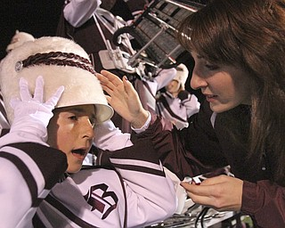 William D LEwis The Vindicator Boardman band member Kaitlin Windt, in wheelchair,  gets help with her hat from Rachel Ruggieri before 11012013 halftime show.