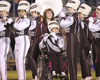 William D LEwis The Vindicator Boardman band member Kaitlin Windt, in wheelchair,  gets help from Rachel Ruggieri during 11012013 halftime show.