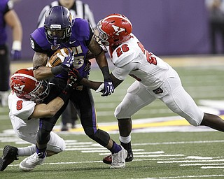 Northern Iowa's Kevin Vereen is tackled by Youngstown State's Donald D'Alesio (#8) and Jameel Smith in the second quarter of the game at the UNI-Dome in Cedar Falls, Iowa, Saturday, Nov. 9, 2013.