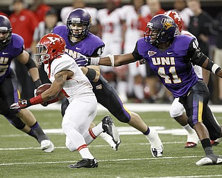 Northern Iowa's Sam Tim gets a hand on Youngstown State's Andre Stubbs in the backfield during in the first half of the game at the UNI-Dome in Cedar Falls, Iowa, Saturday, Nov. 9, 2013.