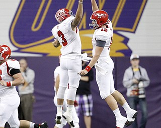Youngstown State quarterback Kenny Bishop celebrates his touchdown with Teven Williams in the first half of the game at the UNI-Dome in Cedar Falls, Iowa, Saturday, Nov. 9, 2013.