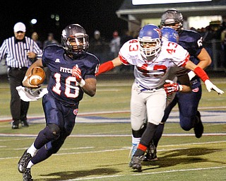 MADELYN P. HASTINGS | THE VINDICATOR..Fitch's Antwan Harris (18) runs with the ball while Marysville's Jesse Ramirez (43) chases after him during their game on November 9, 2013.... - -30-..
