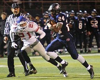 MADELYN P. HASTINGS | THE VINDICATOR..Fitch's Darrin Hall (24) runs with the ball and goes on to score their first touchdown while Marysville's Alec Draughon (21) chases after him during their game on November 9, 2013.... - -30-..