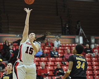 Youngstown State #15 Heidi Schlegel puts up a floater under the basket while VCU #34 Keira Robinson watches.