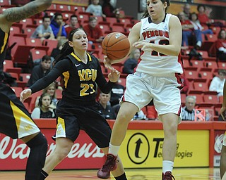 Youngstown State #13 Kelsea Newman misplays th basketball while jumping in the air while being pressured by VCU #23 Jessica Pellechio.