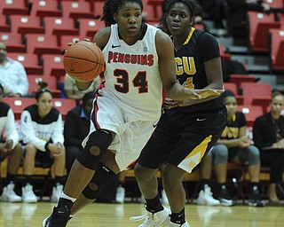 Youngstown State #34 Latisha Walker dribbles down the lane to the basket after getting around VCU #44 Camille Calhoun.