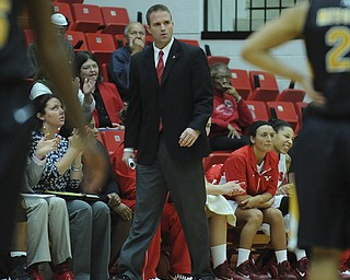 Youngstown State head coach John Barnes walks in front of the YSU bench during the first half of Saturday afternoons game.